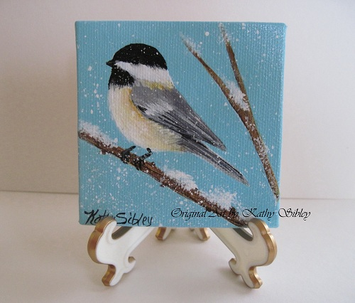 Black Capped Chickadee in the snow